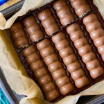 Overhead of oreo mint candy bars placed into brownie batter pan