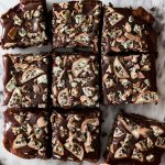 Overhead of oreo mint layered brownies, cut in to squares