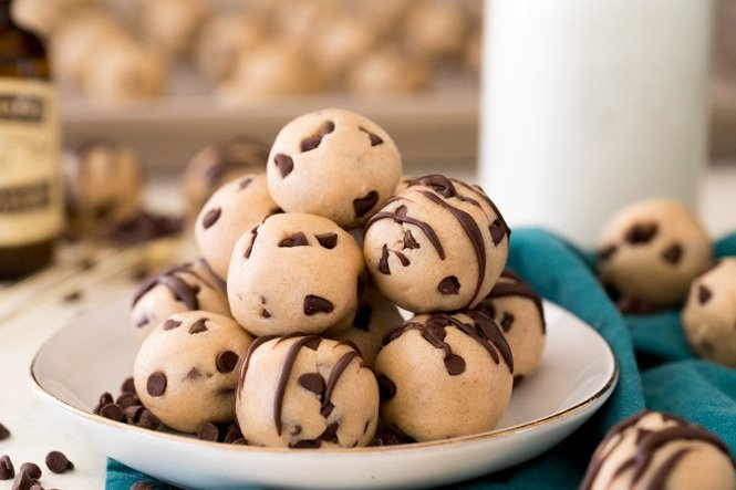 Cookie dough bites piled on a white plate