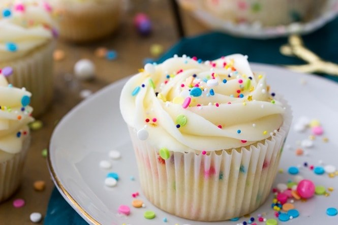 Funfetti cupcake topped with frosting and sprinkles
