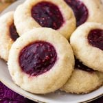 Thumbrint cookies with raspberry filling on plate