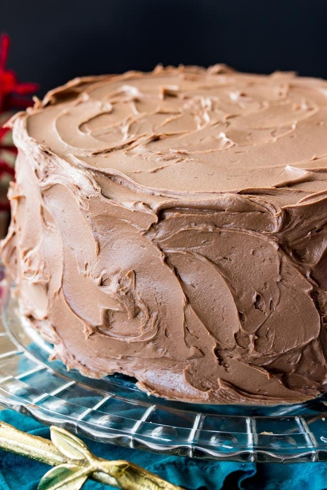 Chocolate frosted cake on cake plate