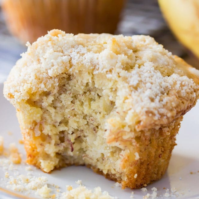 Banana muffin on plate with bite taken out