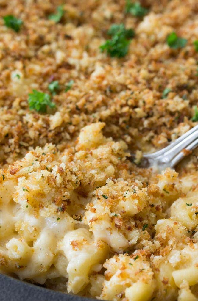 A spoonful of panko-topped mac and cheese in the pan