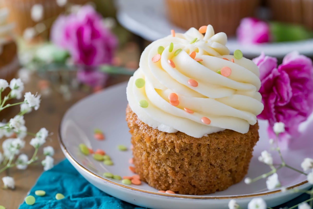 Carrot Cake Cupcake on a plate, surrounded by flowers