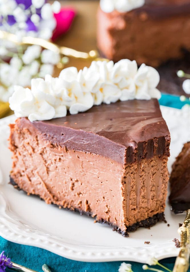 A slice of chocolate cheesecake with a bite missing