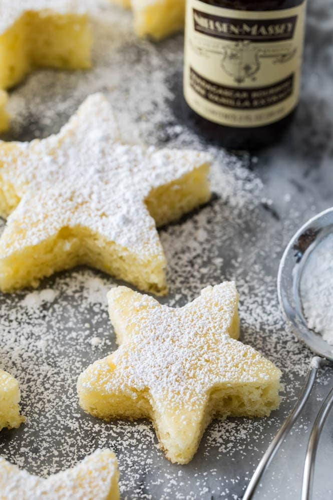 Soft vanilla cake cut into star shapes an dusted with powdered sugar