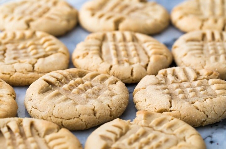 Peanut Butter Cookies cooling on a marble slab