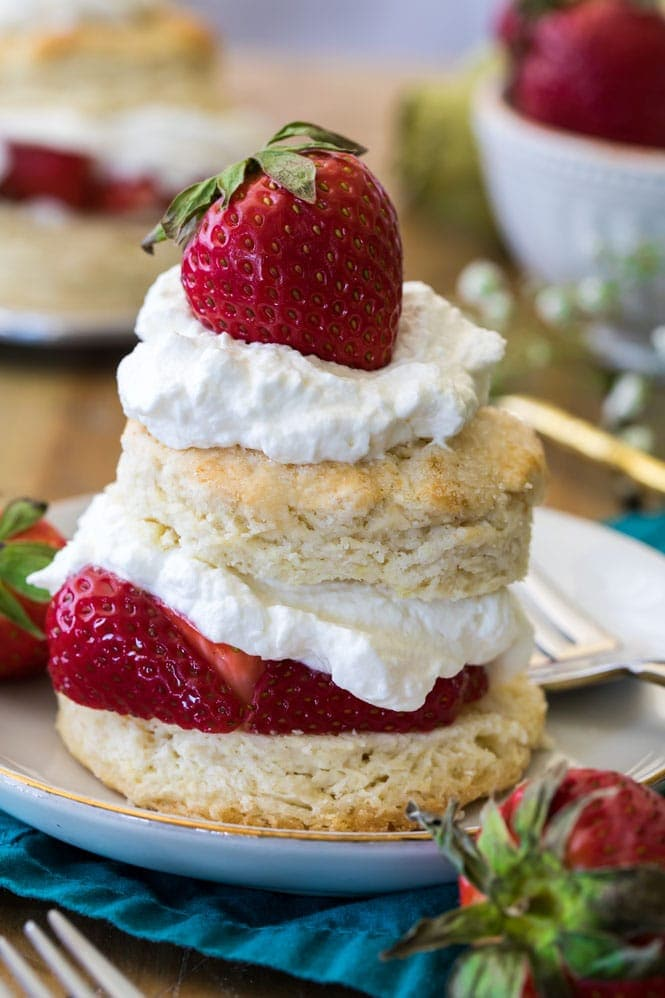 Assembled strawberry shortcake with biscuit, cream, and strawberries