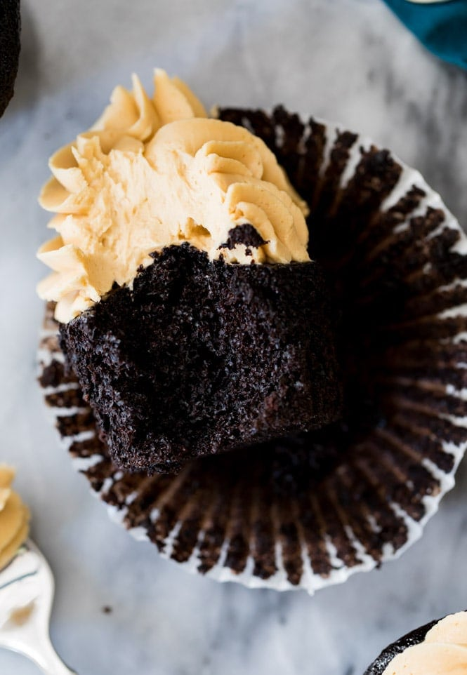 Dark chocolate cupcake with a bite taken out of it