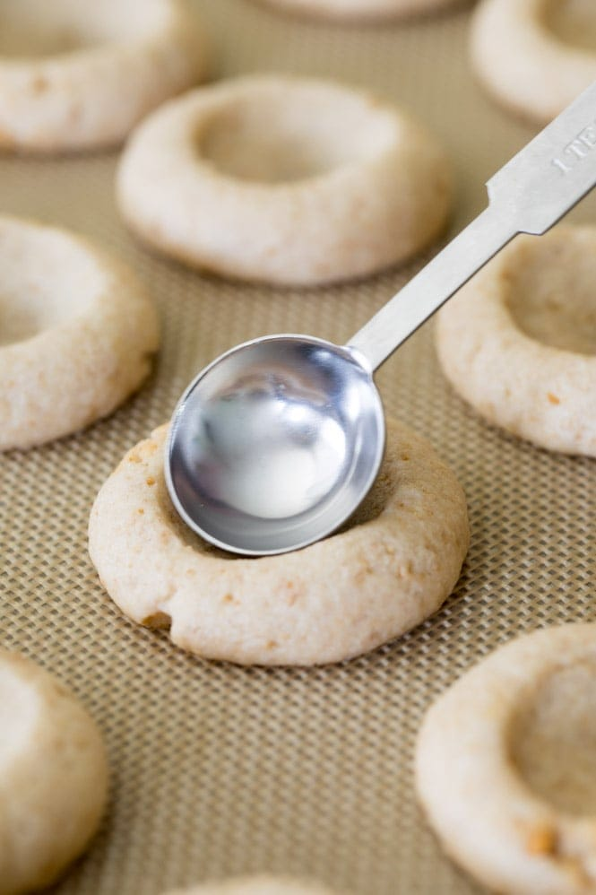 Re-indenting a key lime pie thumbprint cookie after baking