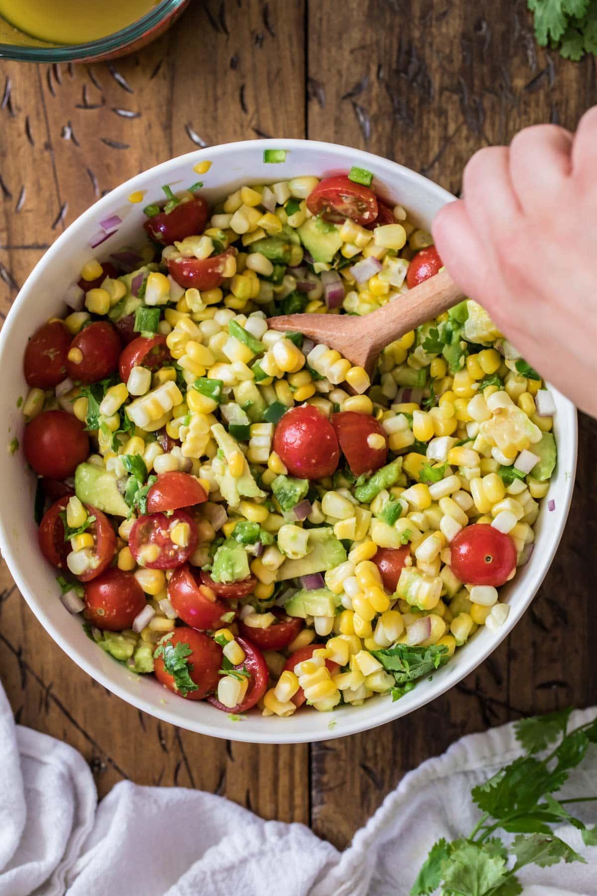Preparing corn salad by combining ingredients