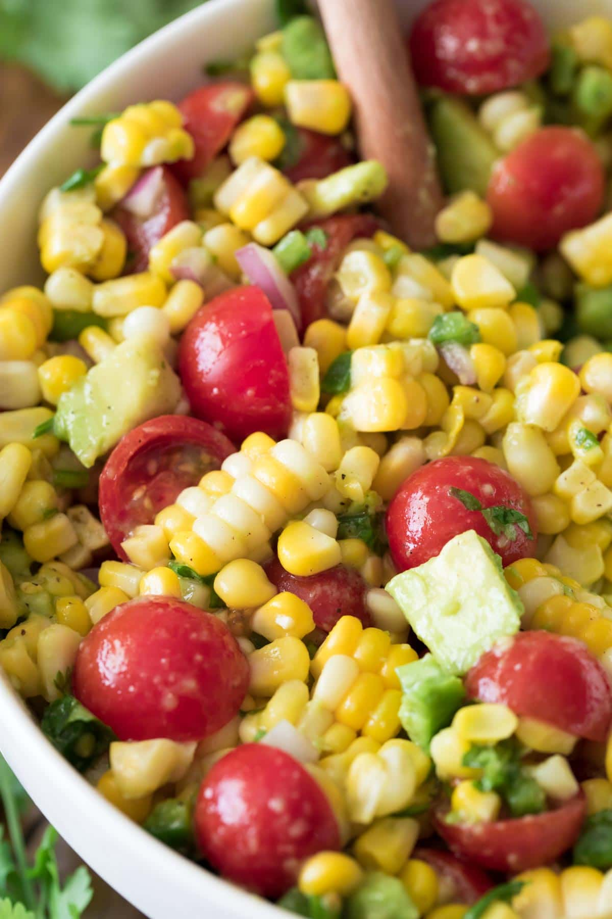 close up of corn salad in white bowl