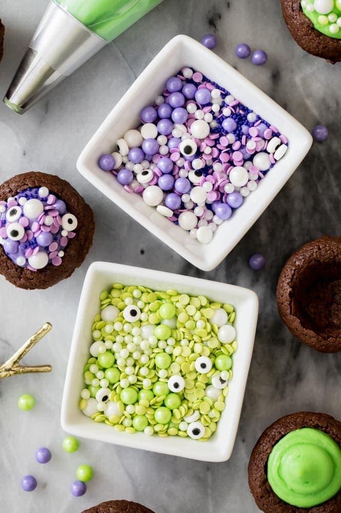 Bowl of green sprinkles; bowl of purple sprinkles