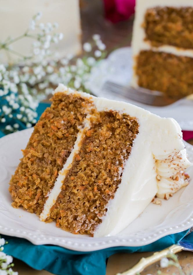 Slice of carrot cake on white plate