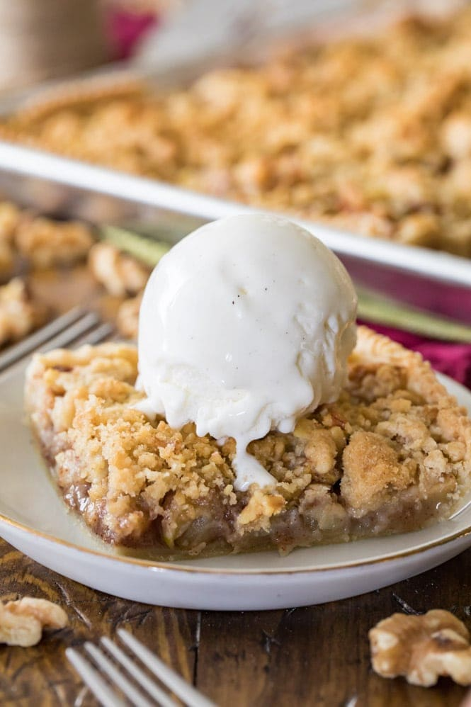 slice of apple slab pie topped with ice cream