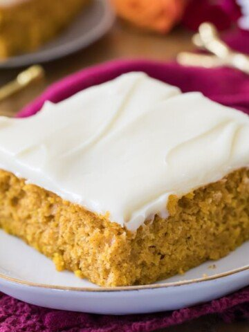 Pumpkin bar slice with icing on plate