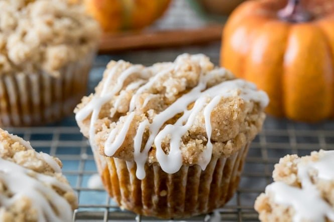 Pumpkin muffin with glaze on cooling rack