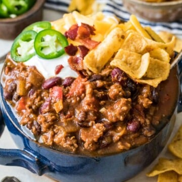 chili in blue bowl with toppings