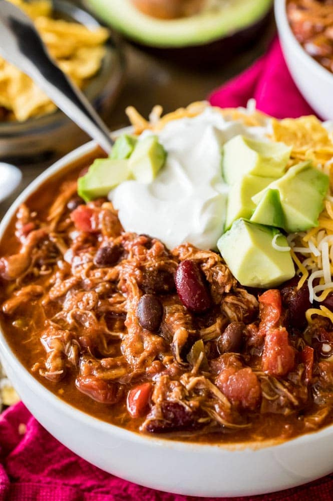Bowl of Turkey Chili topped with sour cream and avocado