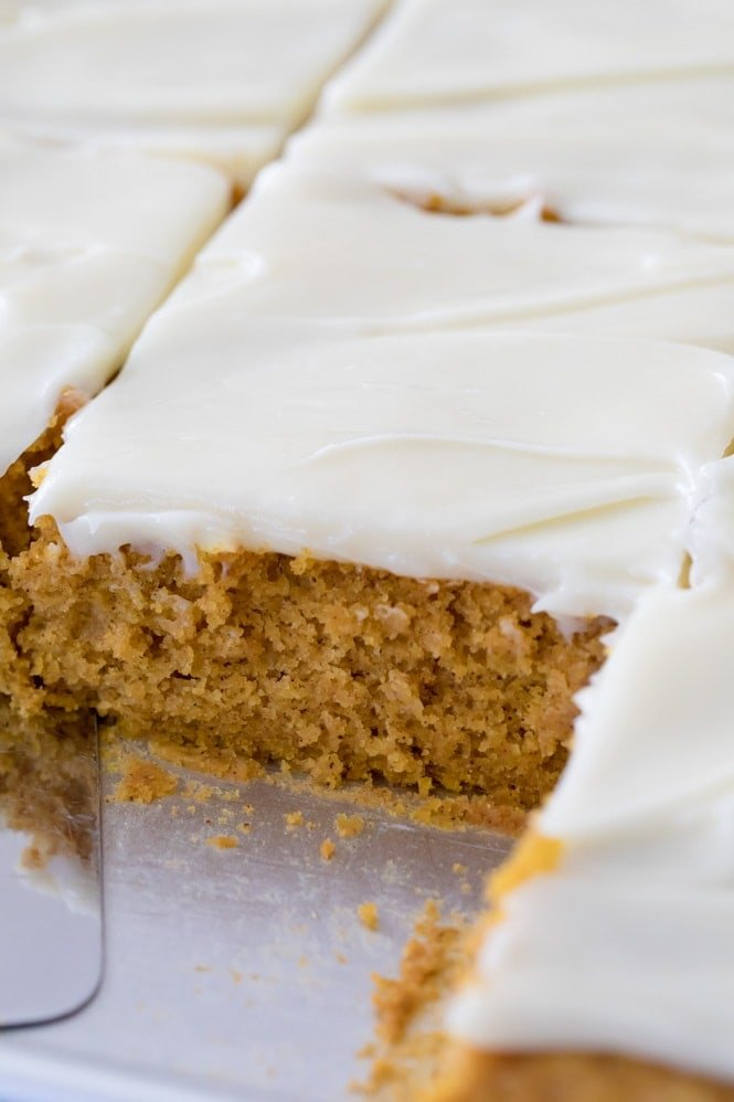pumpkin cookie bar iced with cream cheese frosting