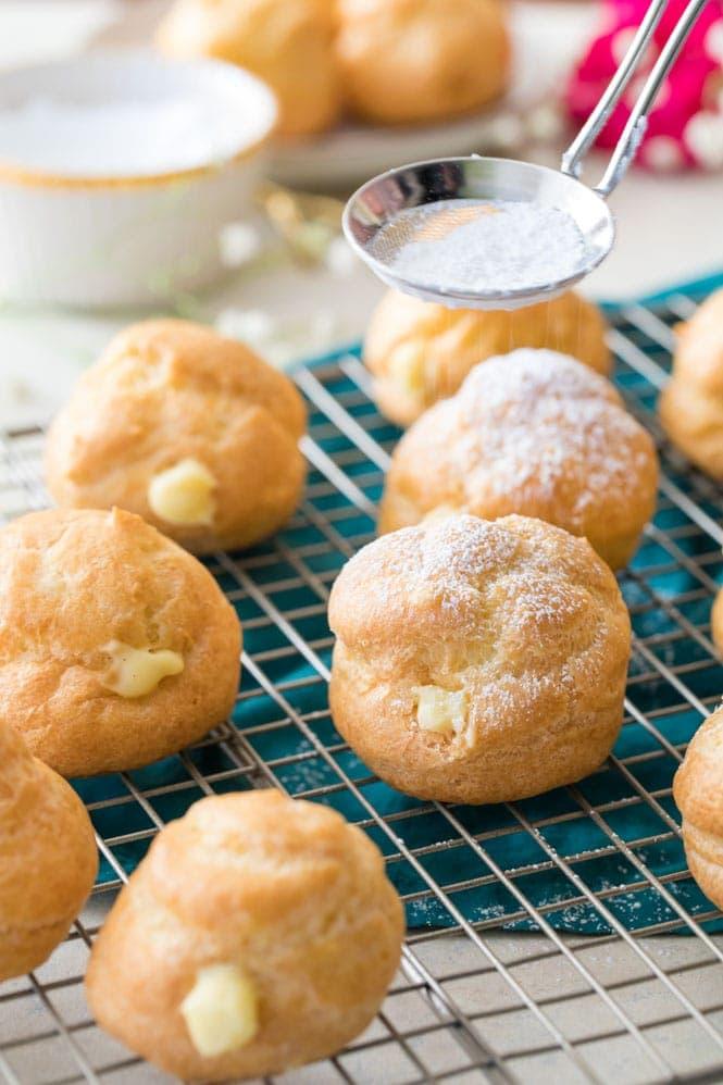 dusting cream puffs with powdered sugar
