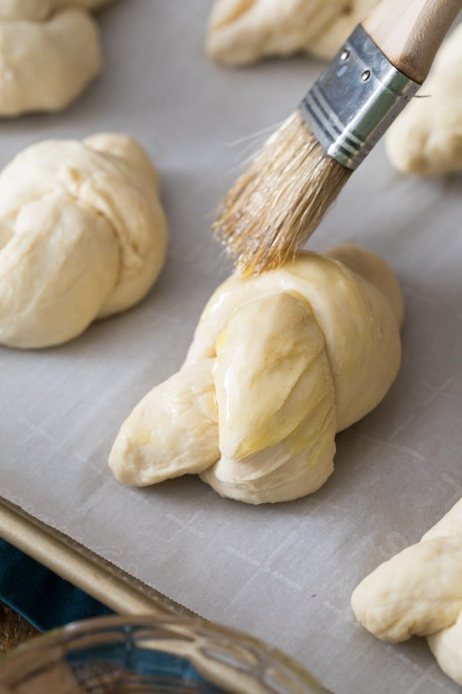 Brushing garlic knot dough with olive oil