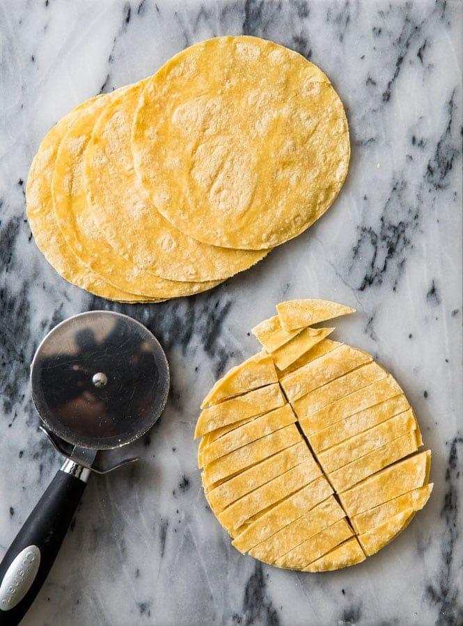 Slicing tortillas into strips for Chicken Tortilla Soup