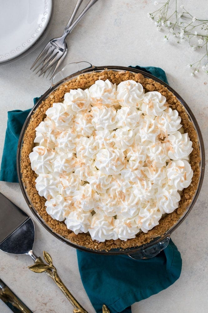 Overhead of coconut cream pie topped with whipped cream and toasted coconut