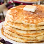 buttermilk pancakes on white plate with butter