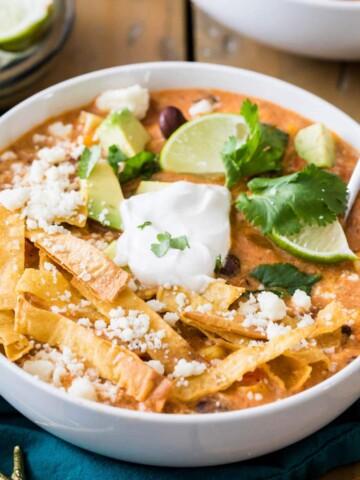 CHICKEN tortilla soup in white bowl