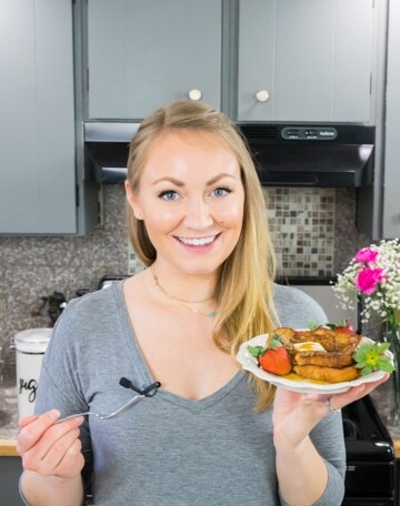 Author (Sam) holding a plate of french toast