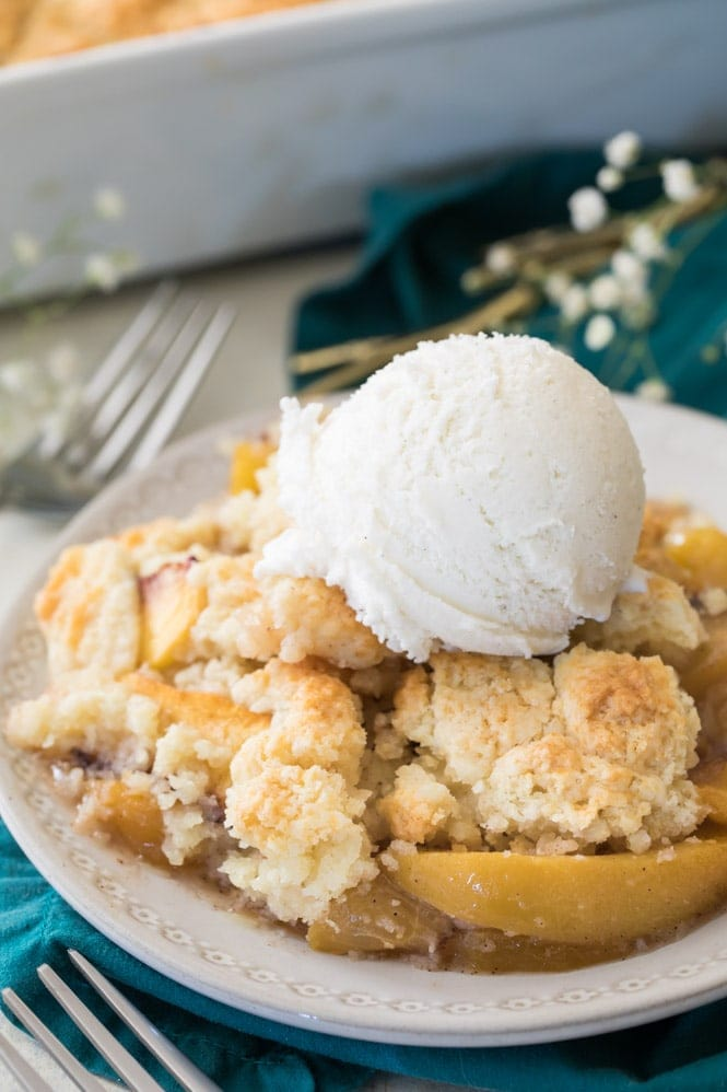 Peach cobbler with scoop of ice cream