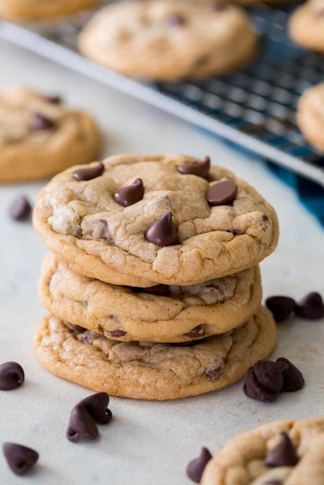 Stack of pudding cookies beside cooling rack