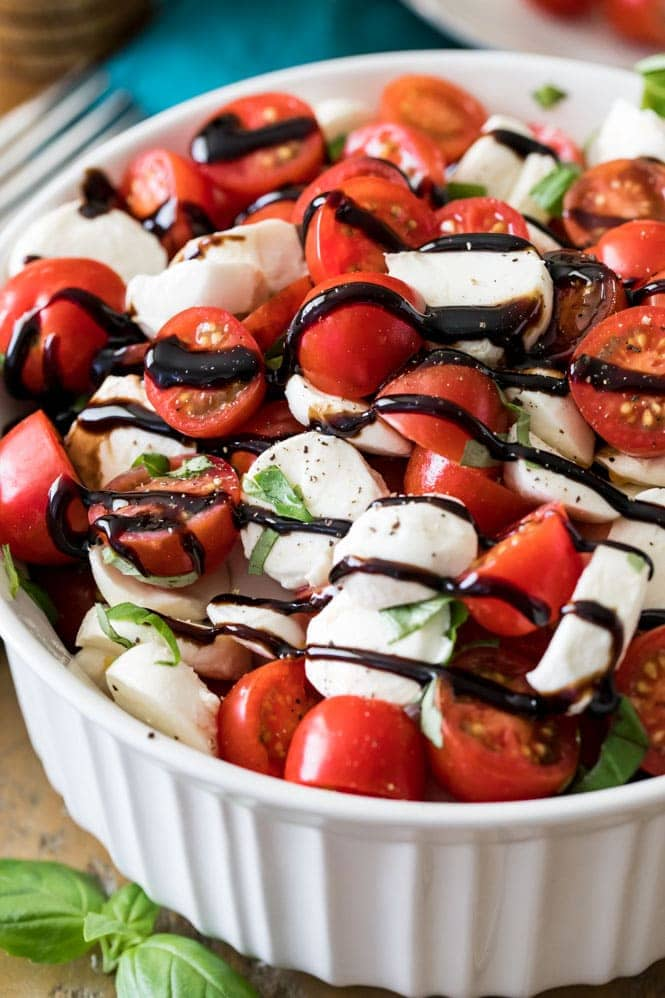 Caprese salad drizzled with balsamic reduction