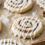 cinnamon roll cookies on parchment paper