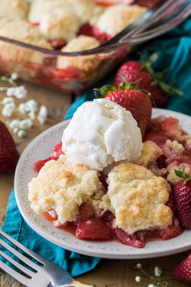 Strawberry cobbler topped with vanilla ice cream