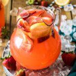 pitcher of strawberry lemonade on ice