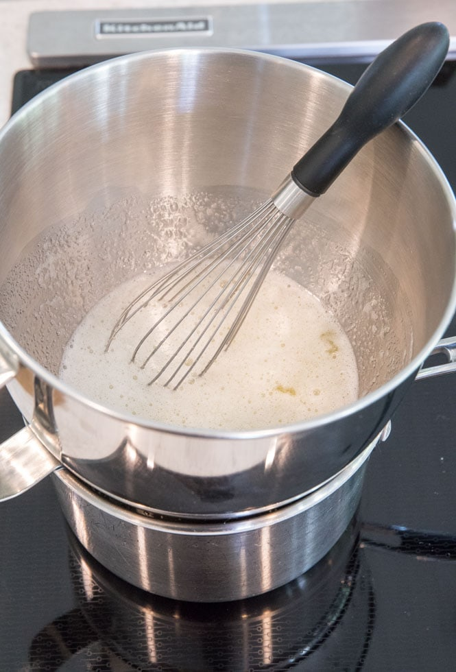 How to prepare Swiss meringue: whisking egg whites, sugar, and salt in double boiler