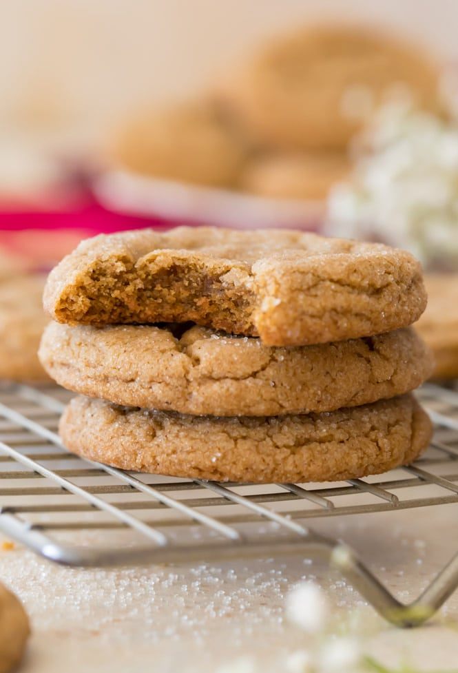 Stack of 3 soft gingersnap cookies on cooling rack