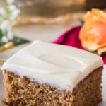 Slice of spice cake on white plate