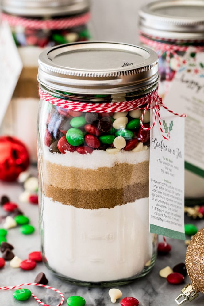 Jar of cookie mix showing layered ingredients and gift tag