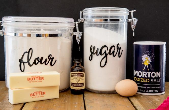 Ingredients for butter cookies (flour, sugar, butter, vanilla, egg, salt)