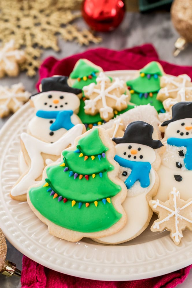 Royal Icing decorated sugar cookies on a white plate