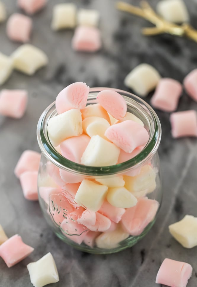 Pink and white butter mints in a glass jar