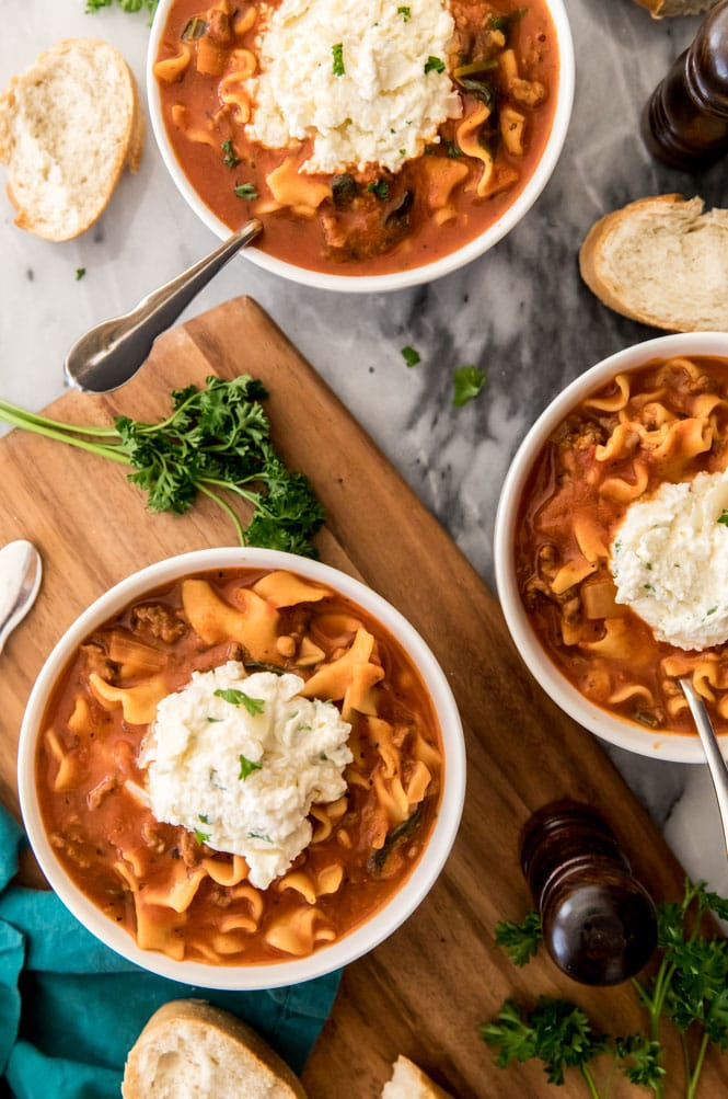 Overhead of lasagna soup with ricotta topping