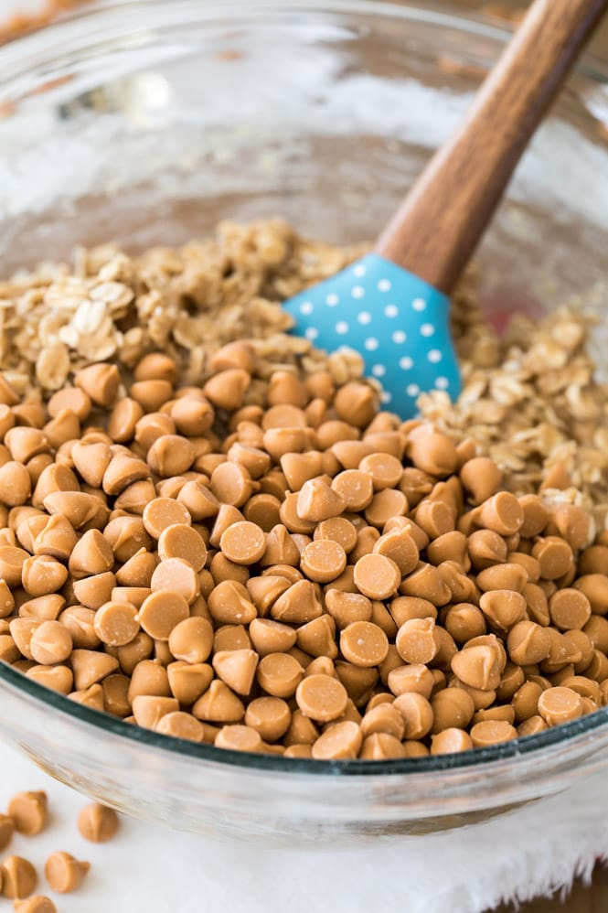 Making cookie dough with butterscotch chips in bowl