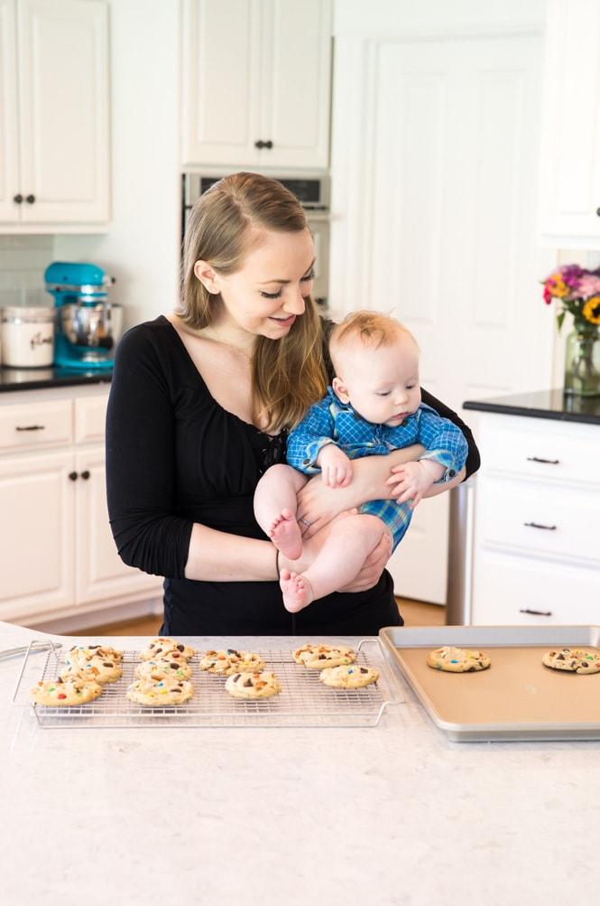 Samantha holding baby Luke in kitchen