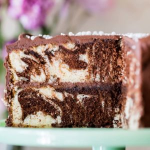 Marble cake on cake platter with slice taken out