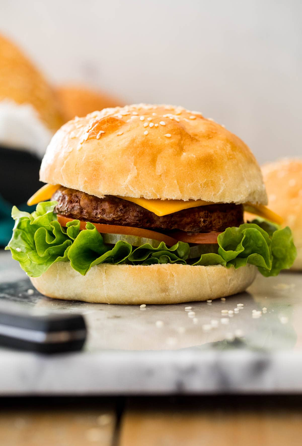 burger on white marble board